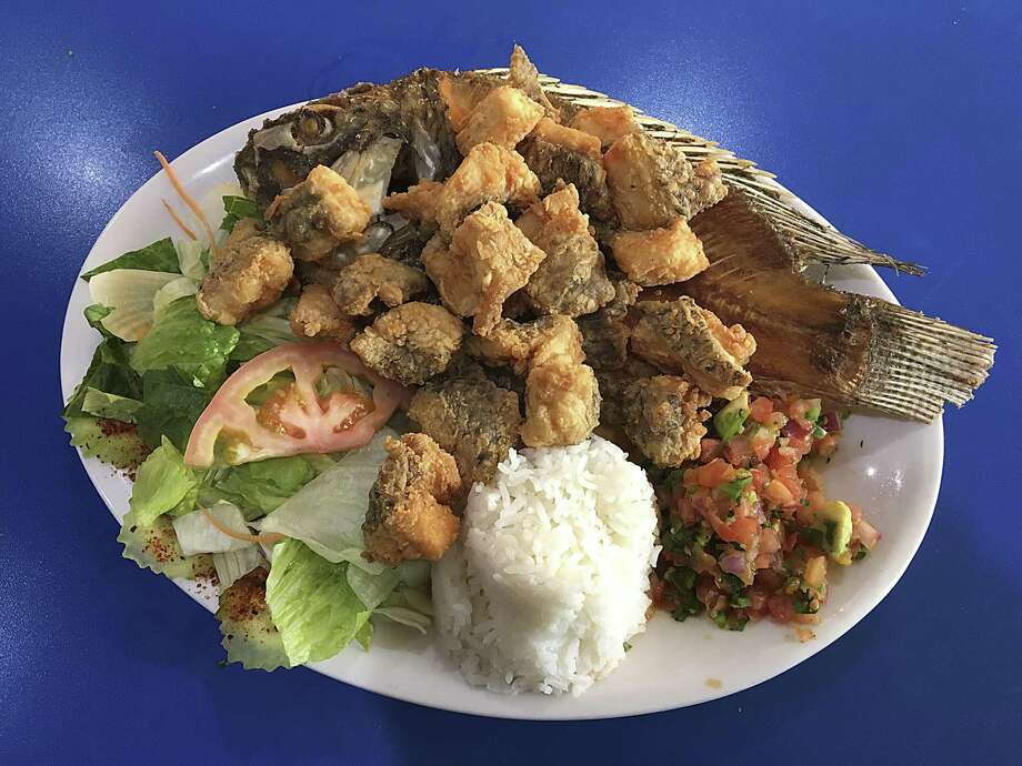 Mojarra Frita en Estilo Chicharrón with salad, rice and pico de gallo from El Bucanero on Embassy Road Photo: Mike Sutter /Staff