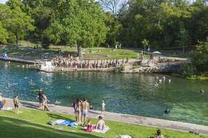 Swimmers on a hot day in Barton Springs Pool. Barton Springs Pool is a man-made recreational swimming pool located on the grounds of Zilker Park in Austin, Texas. The pool exists in the channel of Barton Creek and is filled by water from Main Barton Spring, the fourth largest spring in Texas.