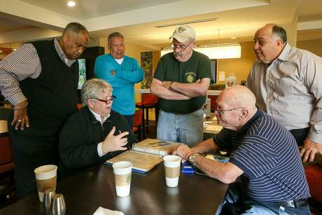 "From left, veterans Edwin ""Doc"" Ayres, Perry Dotson, Ernie Levesque, Ignacio Amaro, Tim ""Porky"" Roland, Armando Moralez and Bill Steele (not pictured) gather in a San Antonio hotel on Sunday, Jan. 13, 2019, for the first time since leaving the jungles of Vietnam in 1970."
