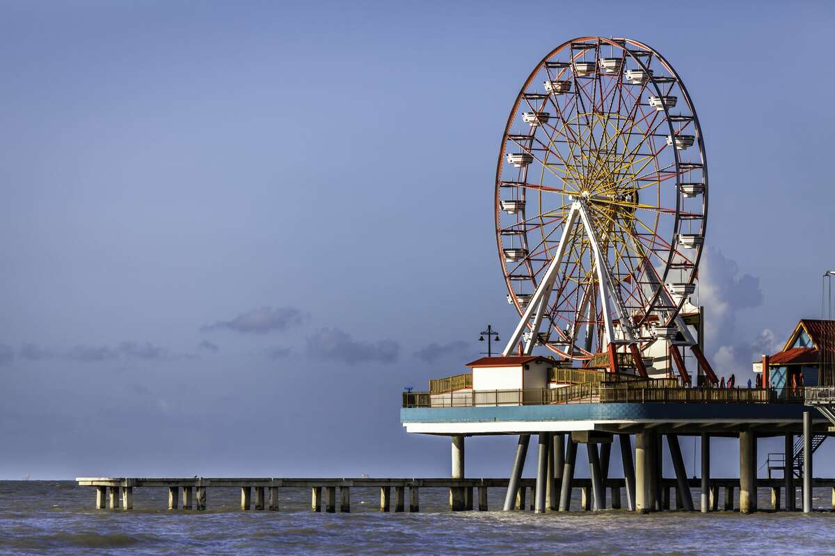 Galveston Island The Galveston Pleasure Pier is an amusement park built on a pier in Galveston, Texas. The pier extends out into the Gulf of Mexico. The Galveston Pleasure Pier is open year round. This image was taken right after sunrise.