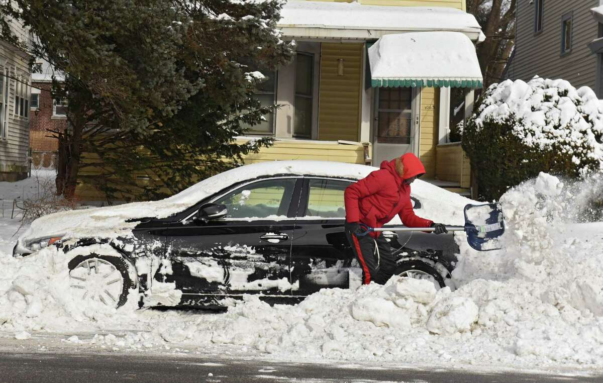 Kashawn Johnson of Albany shovels out his car parked on Madison Ave. on Monday, Jan. 21, 2019 in Albany, N.Y. A snow emergency has been declared for Albany. Beginning at 8 p.m. Monday, all vehicles must be parked on the even numbered side of the street for 24 hours. Beginning at 8 p.m. Tuesday, all vehicles must be parked on the odd numbered side of the street for the following 24-hour period. (Lori Van Buren/Times Union)