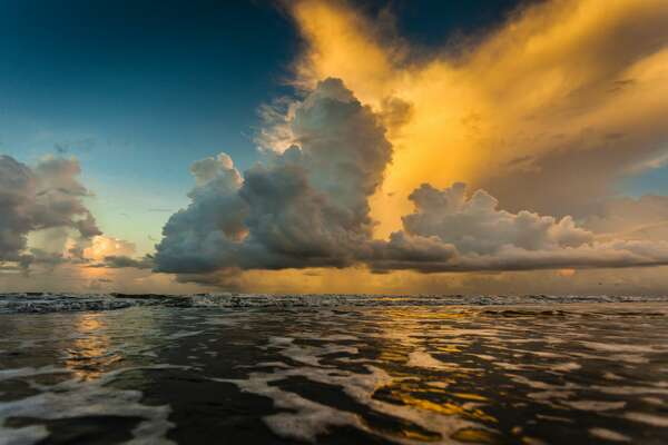 A seascape of a sunrise over the Gulf of Mexico, off of the Texas coast.