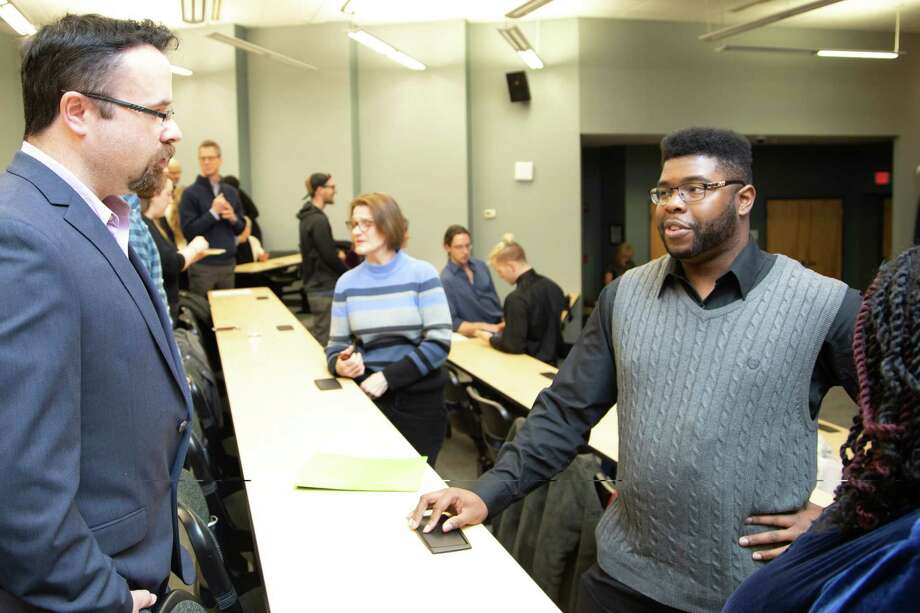 Kevin Coffrin, left, a quality assurance developer at Troy Web Consulting, talks with Albany Can Code graduate Kishon Grant, right, at Thursday's graduation ceremony. Troy Web Consulting is part of Albany Can Code's Employer Network. Photo: Albany Can Code/Mia Ertas Photography