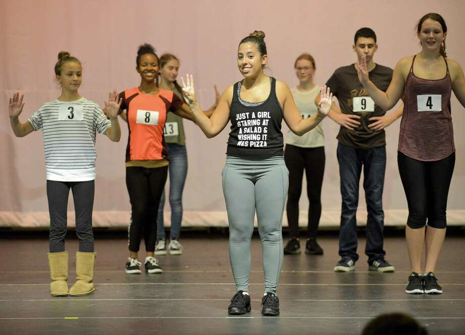 "Jenna Cimaglia, an assistant choreographer, works with students on stage during ""Wizard of Oz"" auditions for Stamford's All-School musical at Rippowam Middle School auditorium in 2017. The theater is overdue for sound and lighting upgrades. Photo: Matthew Brown / Hearst Connecticut Media / Stamford Advocate"