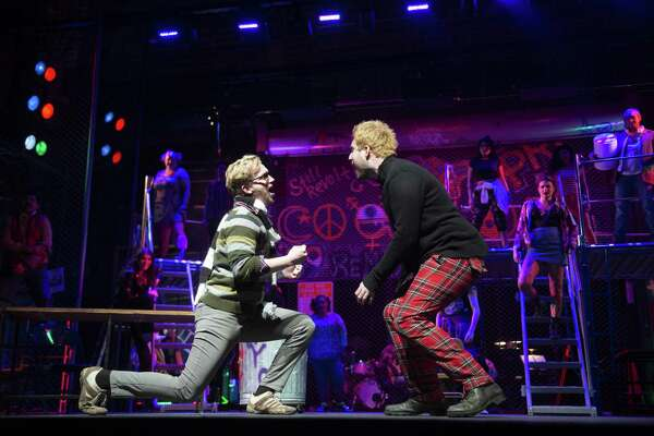 "Gavin Rohrer, from left, and Robby French play roommates and struggling artists in The Public Theater of San Antonio's staging of ""Rent."" The musical is set during the AIDS epidemic."