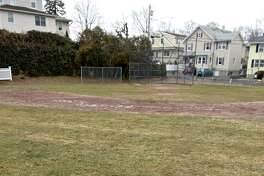 A manhole cover is behind second base at the Hamilton Avenue School field in Greenwich. Neighbors would like to see improvements to the schools field, they feel it is in poor condition.