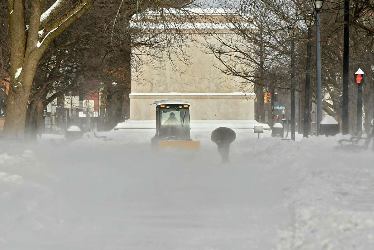 A plow waits for a man to put on snowshoes in Washington Park the day after a snowstorm on Monday, Jan. 21, 2019 in Albany, N.Y. Dangerous snow squalls will move through the Capital Region Sunday afternoon Jan. 27, 2019. (Lori Van Buren/Times Union)