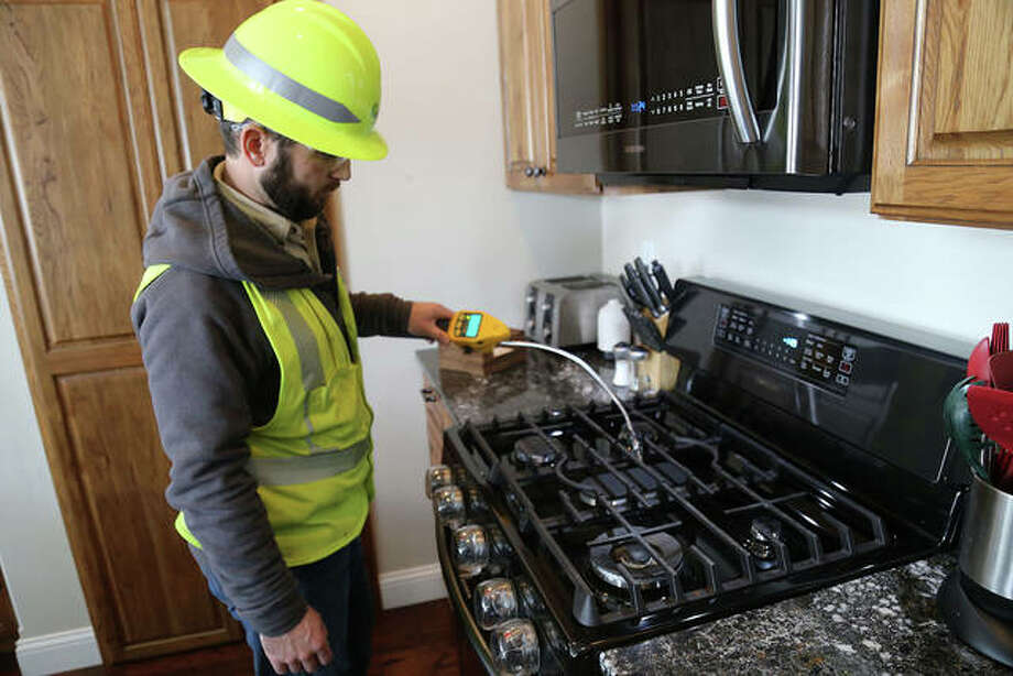 An Ameren Illinois employee checks out a gas stove to ensure it's operating safely. A gas stove is one of many devices homeowners should have checked to avoid potential gas leaks. Photo: Courtesy Of Ameren Illinois