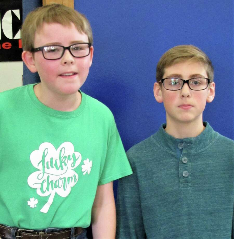 Avrit Casey, left, is the sixth-grade Spelling Bee runner-up at Needville Middle School, and Colton Krobot is the winner. Photo: Needville ISD / Needville ISD