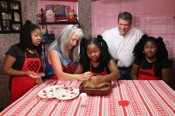 Presenting Sponsors Mary and Tom Solcher enjoying pre-Valentine's baking fun with the Montgomery Triplets (Lauren, Londyn and Lakin), the inspiration of Hope For Three.