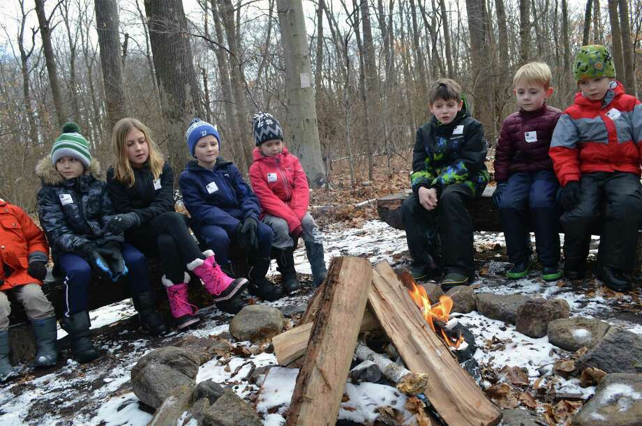 Campers watch the first flames appear at the Darien Nature Center's winter hike and campfire, Friday, Jan. 18, 2019, in Darien, Conn. Photo: Jarret Liotta / For Hearst Connecticut Media / Darien News Freelance