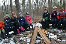 Campers watch the first flames appear at the Darien Nature Center's winter hike and campfire, Friday, Jan. 18, 2019, in Darien, Conn.