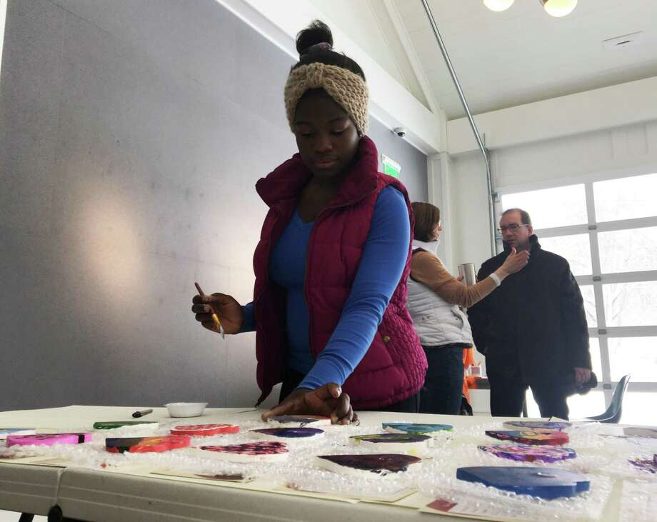 Betty Mark, a sophomore at Shepaug Valley School, helps make Hearts of Hope as part of the inaugural Washington Gives event to commemorate Martin Luther King Jr. Day. Photo: Katrina Koerting / Reporter / The News-Times