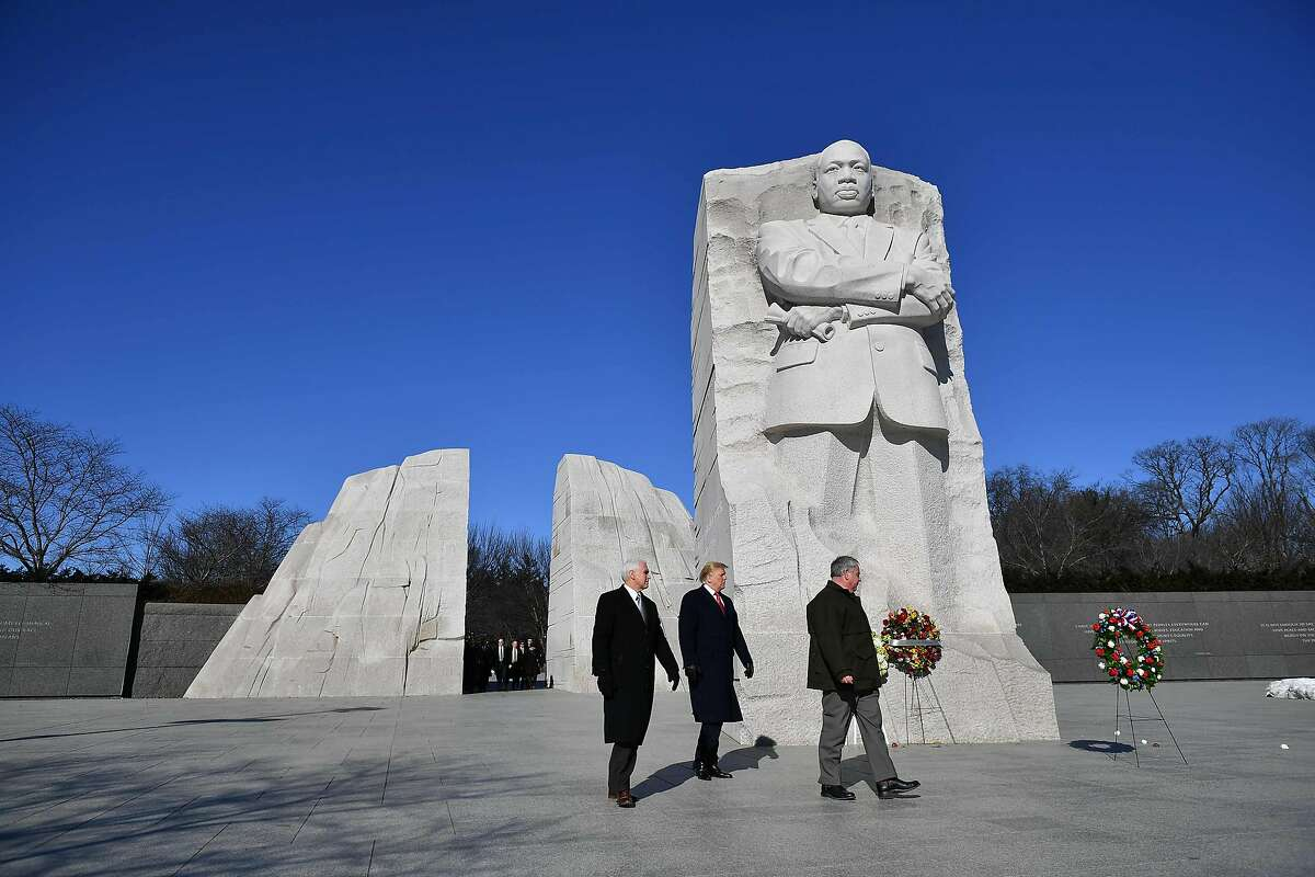 US President Donald Trump(C) and US Vice President Mike Pence(L) visit the Martin Luther King Jr. Memorial in Washington, DC on Martin Luther King Day on January 21, 2019. (Photo by MANDEL NGAN / AFP)MANDEL NGAN/AFP/Getty Images