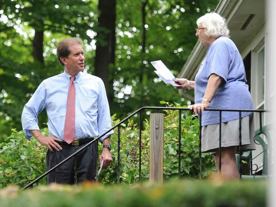 Veteran state Sen. L. Scott Frantz, R-Greenwich, shown here meeting a voter last fall, was upset by Democratic challenger, now-state Sen. Alex Bergstein, who spent about $321,000, including $285,000 of her own money. Photo: Tyler Sizemore / Hearst Connecticut Media / Greenwich Time
