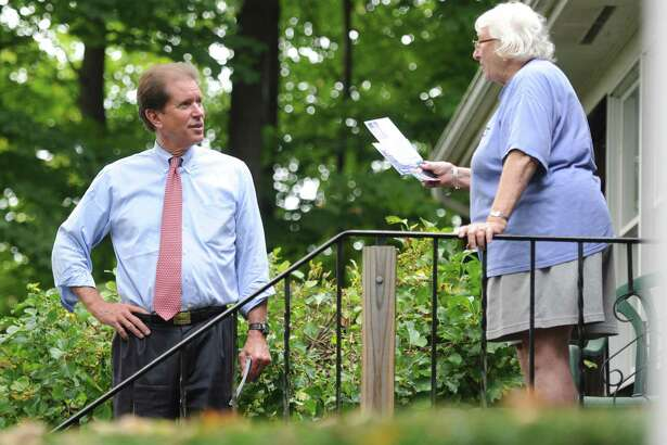 Veteran state Sen. L. Scott Frantz, R-Greenwich, shown here meeting a voter last fall, was upset by Democratic challenger, now-state Sen. Alex Bergstein, who spent about $321,000, including $285,000 of her own money.