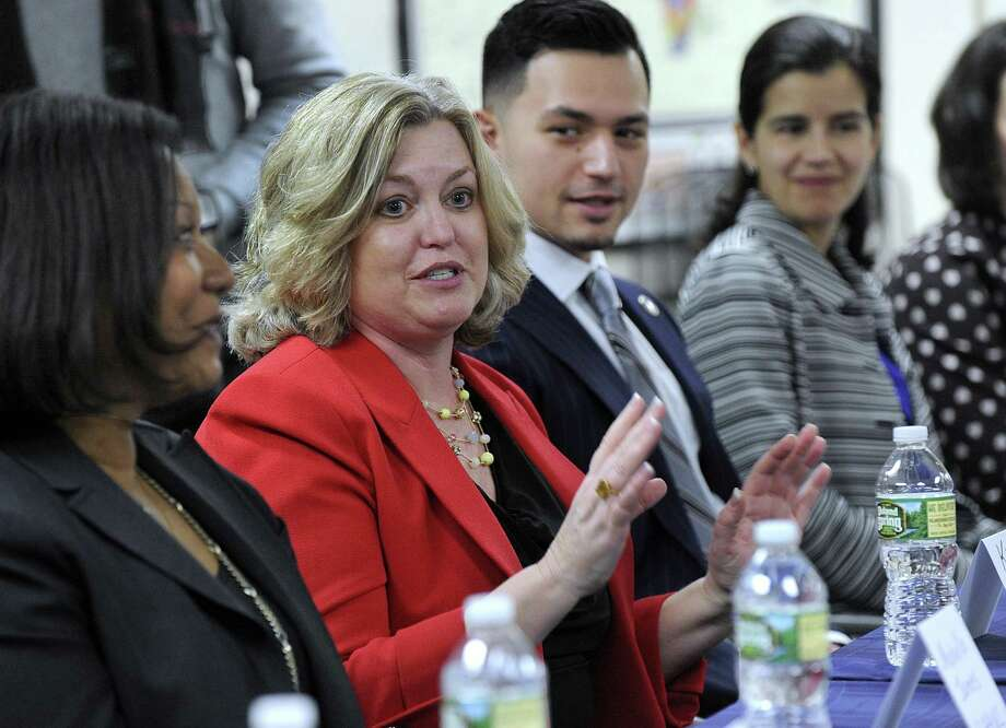 Kim Morgan, center, is the CEO of United Way of Western Connecticut. In this Feb. 6, 2018 photo she is speaking about a grant challenge Danbury won to reduce poverty among immigrants and minorities. Photo: Carol Kaliff / Hearst Connecticut Media / The News-Times