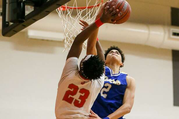 Clemens' Kavon Booker (right) blocks a shot by Judson's Amarea Bailey-Davis during the second half of their District 26-6A boys basketball game at Judson on Friday, Jan. 18, 2019. Clemens beat Judson 80-73.