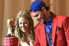 Via Instagram, Jett Reddick posted a photo of the couple's Spider-man themed wedding cake.