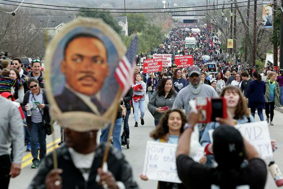 Participants walk in the Martin Luther King Jr. March in San Antonio on Monday, Jan. 21, 2019. Photo: Lisa Krantz, Staff Photographer / Lisa Krantz / San Antonio Express-News