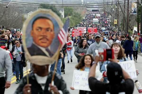 Participants walk in the Martin Luther King Jr. March in San Antonio on Monday, Jan. 21, 2019.