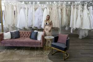 Jerrika Midkiff stands by wedding dresses she selected for her store XO Bridals at 3950 E. 42nd St. Suite B Santa Fe Square on Jan. 7.  Jacy Lewis/191 News