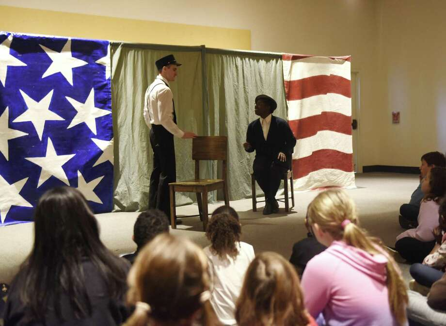 "Above, Madeline Jones and Jesse Kortus perform as Rosa Parks and a bus driver in ""Let it Shine,"" an overview of the most poignant event of the civil rights movement, at the MLK Winter Family Day at the Bruce Museum in Greenwich, Conn. Monday, Jan. 21, 2019. Bright Star Touring Theatre presented ""Heroes of the Underground Railroad,"" which documented the slaves and abolitionists that risked it all to create the Underground Railroad, and ""Let it Shine,"" an overview of the most poignant events of the civil rights movement. In addition, kids created various art inspired by MLK's values of compassion, love, courage and foregiveness. Photo: Tyler Sizemore / Hearst Connecticut Media / Greenwich Time"