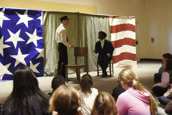 """Above, Madeline Jones and Jesse Kortus perform as Rosa Parks and a bus driver in """"Let it Shine,"""" an overview of the most poignant event of the civil rights movement, at the MLK Winter Family Day at the Bruce Museum in Greenwich, Conn. Monday, Jan. 21, 2019. Bright Star Touring Theatre presented """"Heroes of the Underground Railroad,"""" which documented the slaves and abolitionists that risked it all to create the Underground Railroad, and """"Let it Shine,"""" an overview of the most poignant events of the civil rights movement. In addition, kids created various art inspired by MLK's values of compassion, love, courage and foregiveness."""