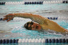 Edwardsville's Noah May completes the freestyle portion of the 400-yard medley relay en route to a first-place finish Monday inside Chuck Fruit Aquatic Center.