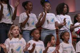 "Members of the Children?'s Mass King Choir sing ?""I?'ll Just Say Yes/Great Work?"" during the annual Dr. Martin Luther King Jr. Celebration on Monday, Jan. 21, 2019 at The Woodlands United Methodist Church."