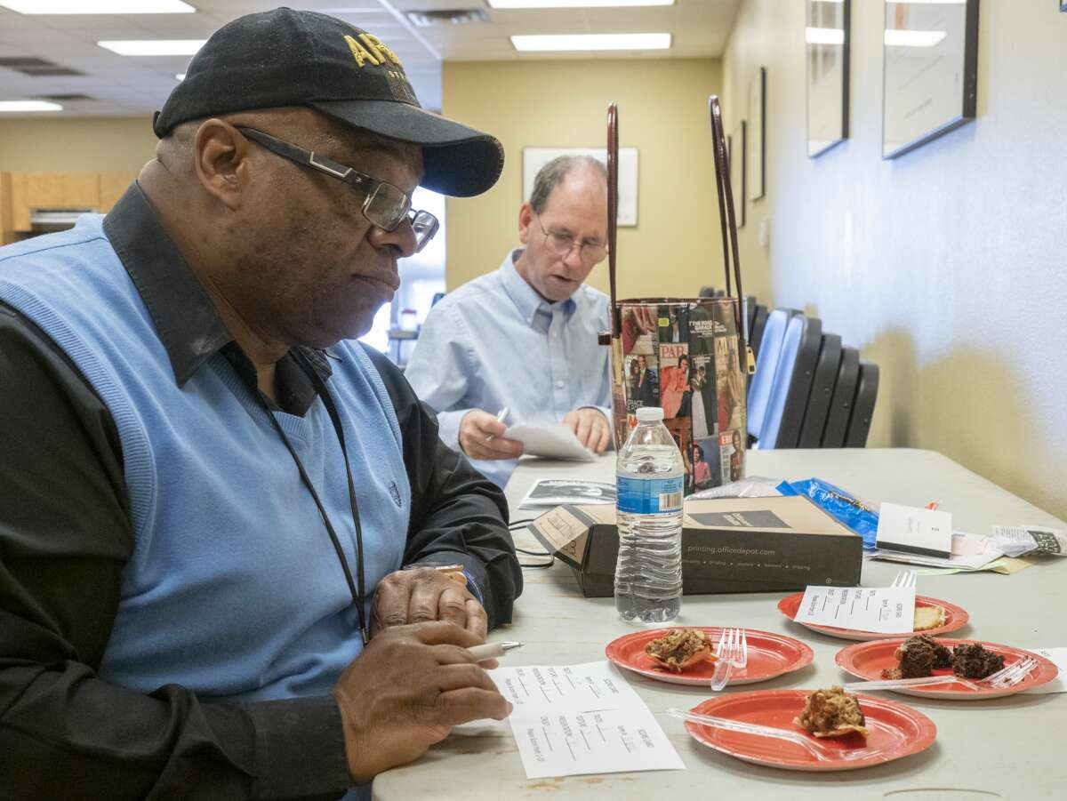 Isaac Garnett and Lee Thompson try samples of entries 01/21/19 during dessert judging at the Martin Luther King Jr. Celebration at the Midland MLK Center. Tim Fischer/Reporter-Telegram