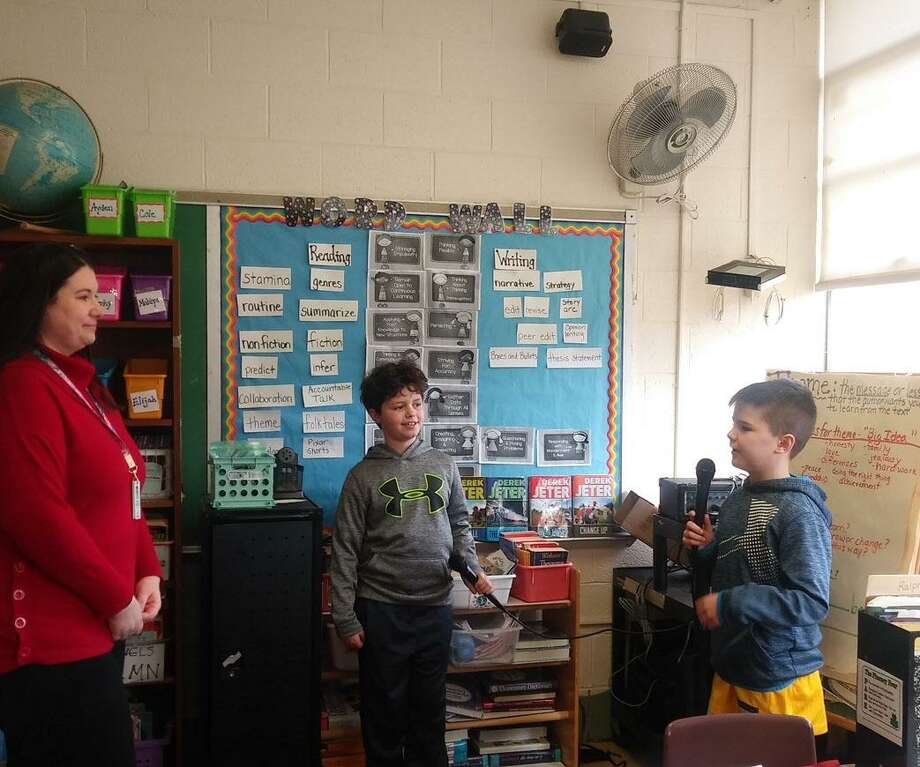 Amanda Wandishion with fourth graders Evan Stanchfield and Cole St. Pierre Photo: Robert Sample