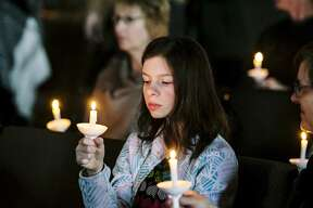 Maya Bansickle, 13, of Beaverton holds her candle at the Right to Life of Midland County annual candlelight prayer vigil held at New Life Vineyard Church on Sunday, Jan. 20, 2019. The vigil was held to commemorate the the 46th anniversary of Roe vs. Wade and those impacted by abortion. (Josie Norris/for the Daily News)