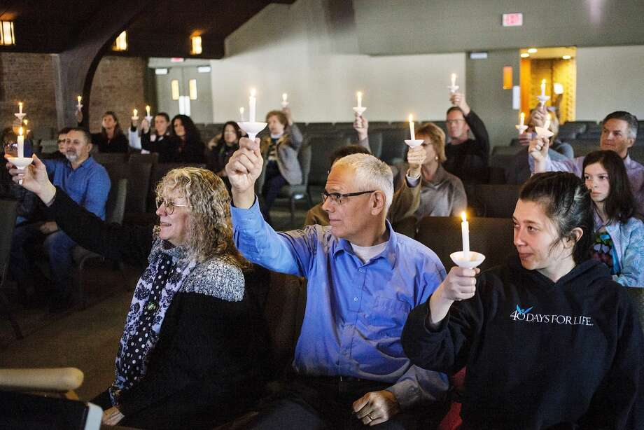 Attendees hold up their candles during the Right to Life of Midland County annual candlelight prayer vigil held at New Life Vineyard Church on Sunday, Jan. 20, 2019. The vigil was held to commemorate the the 46th anniversary of Roe vs. Wade and those impacted by abortion. (Josie Norris/for the Daily News) Photo: Josie Norris/Midland Daily News, (Josie Norris/for The Daily News)