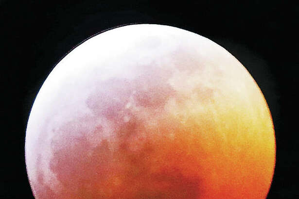 "Despite Sunday's snowstorm, skies cleared Sunday night and early Monday for a great view of the ""Super Blood Wolf Moon"" total lunar eclipse in Alton, though the display could be seen by many across the region. The full moon starts to disappear shortly after the eclipse begins around 9:40 p.m. Sunday. The earth's shadow slowly moves across the moon until it reaches the start of totality, turning reddish-orange, about 10:41 p.m. and concluding just before 1 a.m. Monday. Any full moon in January is a Wolf Moon. Combine it with a Supermoon, a full moon when it is closest to the earth, and you get the ""Super Blood Wolf Moon."""