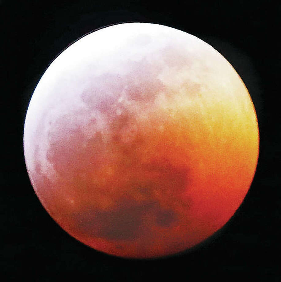 "Despite Sunday's snowstorm, skies cleared Sunday night and early Monday for a great view of the ""Super Blood Wolf Moon"" total lunar eclipse in Alton, though the display could be seen by many across the region. The full moon starts to disappear shortly after the eclipse begins around 9:40 p.m. Sunday. The earth's shadow slowly moves across the moon until it reaches the start of totality, turning reddish-orange, about 10:41 p.m. and concluding just before 1 a.m. Monday. Any full moon in January is a Wolf Moon. Combine it with a Supermoon, a full moon when it is closest to the earth, and you get the ""Super Blood Wolf Moon."" Photo: John Badman 
