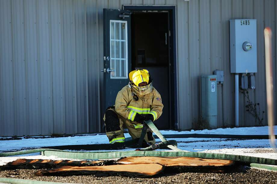 Firefighters with the Butman Township Fire Department secure the scene after putting out a fire with the assistance of other area fire departments on Monday, Jan. 21, 2019 at Nor-Pro Lawn & Landscape, Inc. in Gladwin. (Katy Kildee/kkildee@mdn.net) Photo: (Katy Kildee/kkildee@mdn.net)