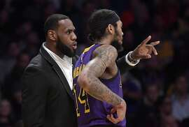Los Angeles Lakers forward LeBron James, left, talks with forward Brandon Ingram during the second half of the team's NBA basketball game against the New York Knicks on Friday, Jan. 4, 2019, in Los Angeles. The Knicks won 119-112. (AP Photo/Mark J. Terrill)