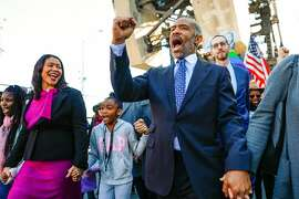 Executive Director at NorcalMLK Foundation Aaron Grizzell (right) sings alongside his Mayor London Breed (left) while participating in the MLK walk to commemorate the 1965 march from Selma to Montgomery, Alabama in San Francisco, California, on Monday, Jan. 21, 2019.