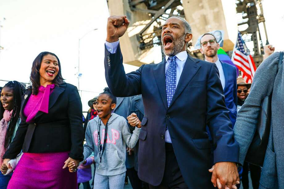 Executive Director at NorcalMLK Foundation Aaron Grizzell (right) sings alongside his Mayor London Breed (left) while participating in the MLK walk to commemorate the 1965 march from Selma to Montgomery, Alabama in San Francisco, California, on Monday, Jan. 21, 2019. Photo: Gabrielle Lurie / The Chronicle