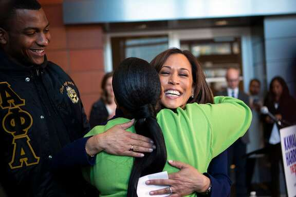 California Senator Kamala Harris embraces the Howard University Student Association's vice president Mara A. Peoples as president Amos Jackson III looks on. Harris had just finished answering questions at a press conference regarding her plan to run for president in 2020 at Howard University in Washington, D.C. on January 21, 2019.