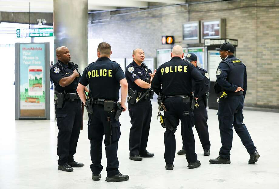 Police chat at they monitor the BART station at Civic Center in San Francisco, California, on Thursday, Aug. 16, 2018. Photo: Gabrielle Lurie / The Chronicle 2018