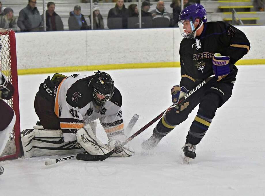 CBA's Hunter Pemrick tries to get the puck past Burnt Hills-Ballston Spa goalie Kyle Grace during a hockey game at the Albany County Hockey Facility on Monday, Jan. 21, 2019 in Colonie, N.Y.  (Lori Van Buren/Times Union) Photo: Lori Van Buren, Albany Times Union / 40045990A