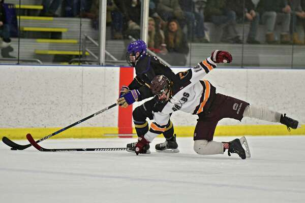 Burnt Hills-Ballston Spa's Miles Grabb, right, dives to knock the puck away from CBA's Mike Cochran during a hockey game at the Albany County Hockey Facility on Monday, Jan. 21, 2019 in Colonie, N.Y. (Lori Van Buren/Times Union)