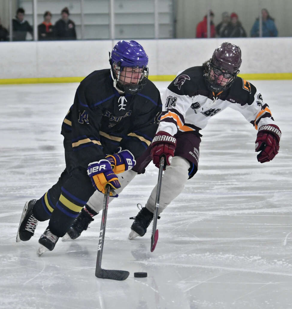 CBA's Dale Hammond, left, and Burnt Hills-Ballston Spa's Miles Grabb battle for the puck during a hockey game at the Albany County Hockey Facility on Monday, Jan. 21, 2019 in Colonie, N.Y. (Lori Van Buren/Times Union)