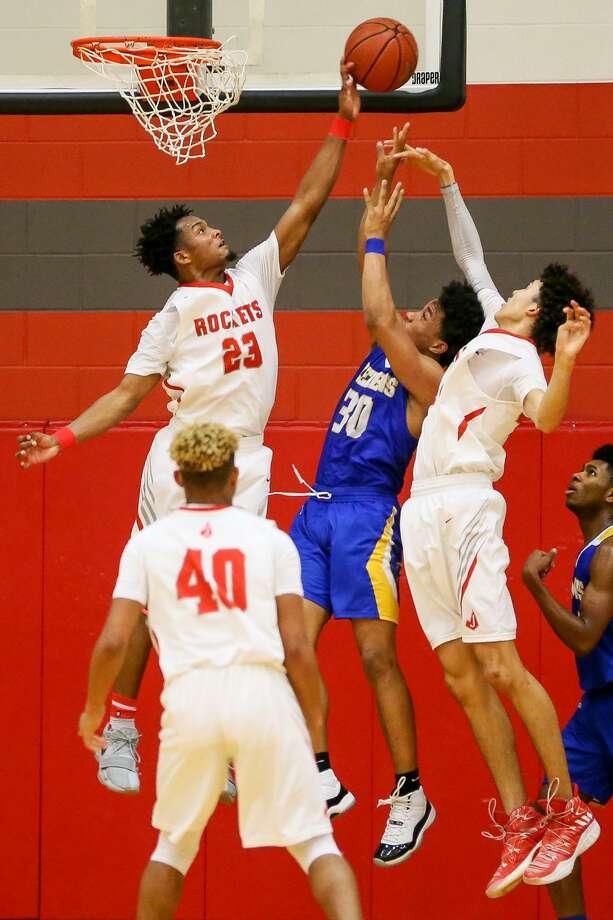 Judson's Amarea Bailey-Davis (left) blocks a shot by Clemens' Mason Chambers while Dhimani Hernandez helps during the  District 26-6A game. Photo: Marvin Pfeiffer /Staff Photographer / Express-News 2019