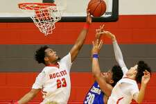Judson's Amarea Bailey-Davis (left) blocks a shot by Clemens' Mason Chambers while Dhimani Hernandez helps during the District 26-6A game.