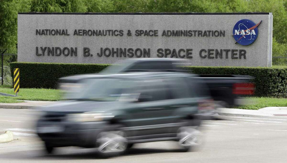 Cars pass by NASA's Johnson Space Center Tuesday, Oct. 1, 2013, in Houston.A NASA manager on Thursday tweeted a photo of a sign asking for volunteers to clean up the bathrooms once a week until the shutdown ends. >>Those close to NASA have made their feelings clear regarding the shut down. See how in the photos that follow...