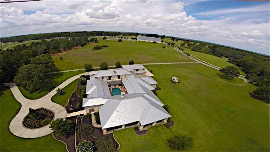 Located at 24004 Lakeview Way in Montgomery, this 10,587 square-foot ranch is a one of a kind home with colorful, intriguing interior and amenities that include a home theater room and a jaw-dropping veranda and pool that overlooks a pasture. Photo: Houston Association Of Realtors