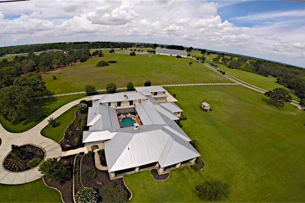Located at 24004 Lakeview Way in Montgomery, this 10,587 square-foot ranch is a one of a kind home with colorful, intriguing interior and amenities that include a home theater room and a jaw-dropping veranda and pool that overlooks a pasture.